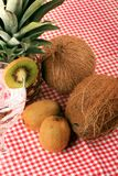 Pineapple, cocos, kiwi and mineral water Royalty Free Stock Photos