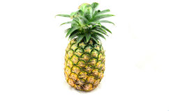 Pineapple. Colorful pineapple at a white background stock image