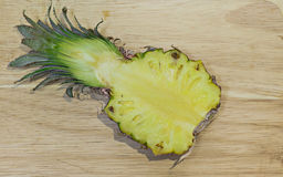 Pineapple cut in half, delicious yellow inside. Pineapple cut in half, delicious yellow inside Royalty Free Stock Images