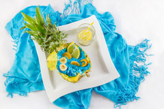 Pineapple cut in half with sliced fruit and lemon coctail top vi Royalty Free Stock Photos