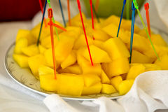 Pineapple. Cut into pieces, put on a platter Royalty Free Stock Photo
