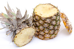Pineapple cut on the top and on the bottom Stock Photography