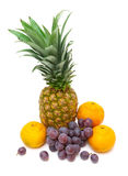 Pineapple, dark grapes and tangerines isolated on a white backg. Ripe fresh fruit: pineapple, dark grapes and tangerines isolated on a white background. vertical royalty free stock photo