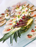 Pineapple delicacy. Some fish delicacy served on a pineapple fruit royalty free stock images