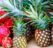 Pineapple and Dragonfruit on farmers market table. Fruit at the farmer`s market at the Saturday morning farmer`s market at the Community College, Puhi, Kauai Royalty Free Stock Images