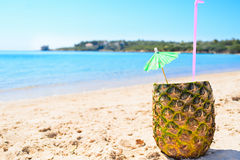 Pineapple drink on the sand Stock Photos