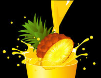 Pineapple falling in juice Royalty Free Stock Photo