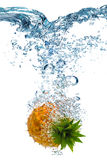 Pineapple falls deeply under water Royalty Free Stock Images