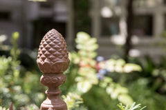 Pineapple Fence Post. In an outdoor garden, which is symbolic of hospitality in the US.  Selective focus on the pineapple.  Copy space on right Royalty Free Stock Image