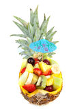 Pineapple filled with fresh summer fruits. Hollowed pineapple filled with fresh summer fruits over white background Stock Images