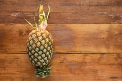 Pineapple. Freshly  on wooden background. Top view Royalty Free Stock Photos