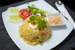 Pineapple Fried Rice. Baked rice with pineapple or Pineapple Fried Rice with Shrimp and dried shredded pork in white dish Royalty Free Stock Photography