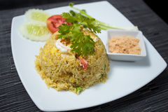 Pineapple Fried Rice. Baked rice with pineapple or Pineapple Fried Rice with Shrimp and dried shredded pork in white dish Stock Image