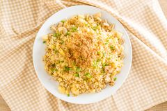 Pineapple fried rice. With dried shredded pork stock photos
