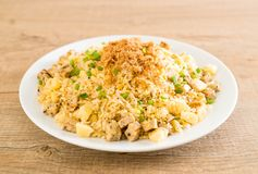 Pineapple fried rice. With dried shredded pork royalty free stock images