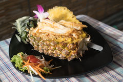 Pineapple fried rice - a traditional dish of Thailand Stock Photo