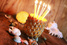 Pineapple fruit with birthday candles Royalty Free Stock Image