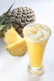 Pineapple fruit juice. On clean background Royalty Free Stock Photo