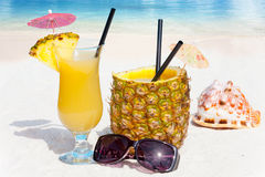 Pineapple fruit and juice on the beach Stock Photo