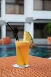 Pineapple fruit juice beverage. At hotel swimming pool outdoor Royalty Free Stock Photos