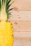 Pineapple fruit and pulp. On wooden table Stock Image
