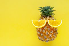 Pineapple fruit with slice oranges set as the eyes royalty free stock photo