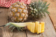 Pineapple fruit slice on wooden. Royalty Free Stock Image