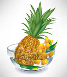 Pineapple fruit and slices in bowl Royalty Free Stock Photo