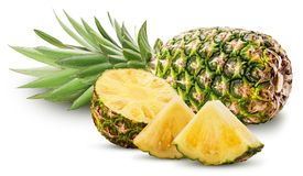 Pineapple fruit whole and cut in half and slice with green leave Stock Photos