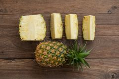 Pineapple fruit on wood table, picec of pineapple fruit for diet. Healthy royalty free stock photos