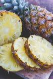 Pineapple fruit on wood table Stock Photo
