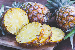Pineapple fruit on wood table Royalty Free Stock Images