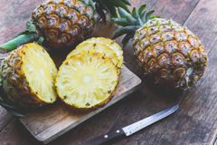 Pineapple fruit on wood table Royalty Free Stock Photography