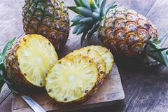 Pineapple fruit on wood table Royalty Free Stock Image