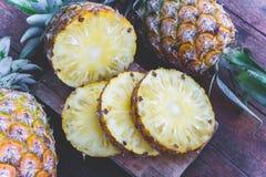 Pineapple fruit on wood table Stock Image