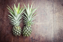 Pineapple fruit on wooden Stock Images