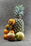 Pineapple fruits,apples and orange Stock Photography