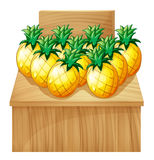 A pineapple fruitstand with an empty board Royalty Free Stock Photos