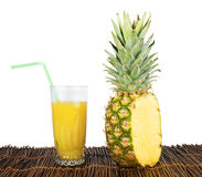 Pineapple and glass of juice Royalty Free Stock Image