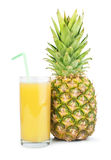 Pineapple and glass of juice Stock Photos