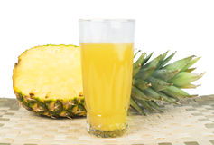Pineapple and glass of juice Royalty Free Stock Photos