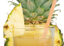 Pineapple and glass of juice Royalty Free Stock Photo