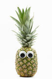 Pineapple with googly eyes on white background. Pineapple face Royalty Free Stock Image