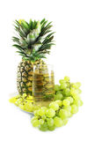 Pineapple, grapes and juice Royalty Free Stock Photos