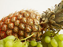 Pineapple and grapes2 Stock Photo