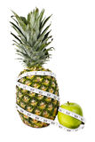 Pineapple and green apple in measuring tape Stock Photos