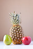 Pineapple, Green Pear and Red Apple Stock Photos