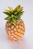 Pineapple on a grey surface Royalty Free Stock Images