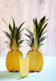 Pineapple half and pineapple juice in a glass Stock Photography