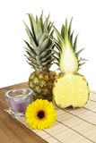 Pineapple and half on tabletop of acacia wood Stock Photos